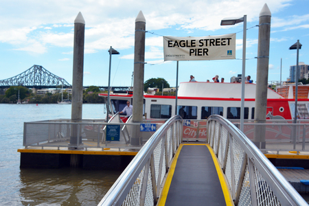 sustained: BRISBANE, AUS - SEP 25 2014:CityFerry at Eagle Street Pier ferry wharf in Brisbane, Australia.In January 2011 it sustained damage during the devastating floods.