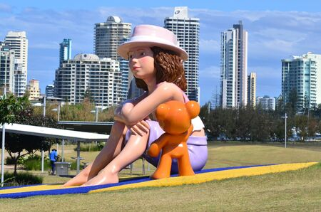 fibreglass: GOLD COAST - OCT 16:  Fibreglass sculpture of a child and her teddy bear in THE HILL at Southport Broadwater Parklands in Gold Coast Queensland Australia.Its  a 2.5-metre 8 ft 2 in high. Editorial