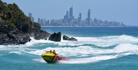 observant: GOLD COAST - NOV 09 2014:Australian Lifeguards in Gold Coast Australia.Australian Lifeguards are world-renown for their high levels of skill and knowledge in accident prevention and rescue response