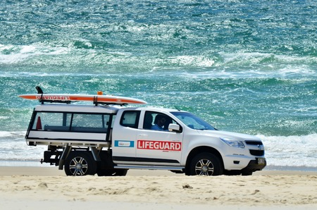 COOLANGATTA - OCT 07 2014: Australian Lifeguards in Gold Coast Australia.Australian Lifeguards are world-renown for their high levels of skill and knowledge in accident prevention and rescue response Editorial