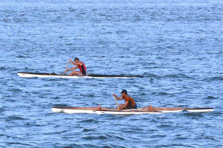 paddler: GOLD COAST - OCT 08 2014:Australian men sea kayaking.Its a very popular sport in the waterway of the Gold Coast in Queensland, Australia. Editorial