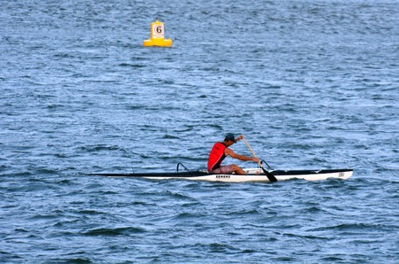 paddler: GOLD COAST - OCT 08 2014:Australian man sea kayaking.Its a very popular sport in the waterway of the Gold Coast in Queensland, Australia.