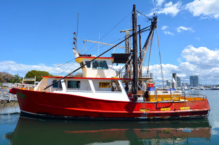 fishingboat: GOLD COAST, AUS - OCT 16 2014:Fishing trawlers mooring at Gold Coast Fishermens Co-Operative.Since 2008 the Gold Coast fishermen selling their catch direct to the public from the boat at low price.
