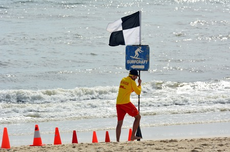 first australians: GOLD COAST, AUS - NOV 02 2014:Australian Lifeguard in Gold Coast Australia.Australian Lifeguards are world-renown for their high levels of skill and knowledge in accident prevention and rescue response