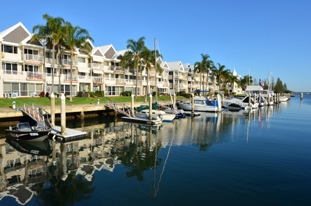 navigable: GOLD COAST - SEP 30 2014:Boats moor in Runaway Bay Marina.With 9 times more waterways than Venice, the Gold Coast is a boating paradise with over 260 kilometres of navigable waterways within the city.