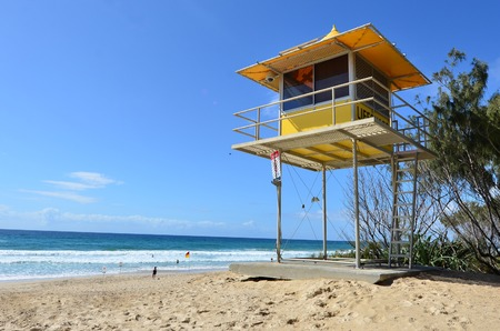 lifesaving: GOLD COAST - SEP 28 2014: Australian Lifeguards tower in Gold Coast Australia.Australian Lifeguards are world-renown for their high levels of skill and knowledge in accident prevention and rescue response Editorial