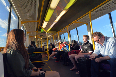 goldcoast: GOLD COAST, AUS - SEP 23 2014:Passengers in Queensland Rail train car.Queensland Rail have 48.5 million customer journeys on the City network (south-east Queensland) per year