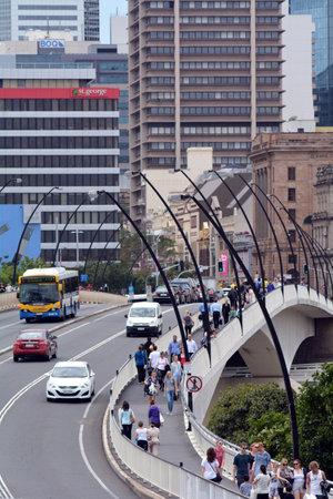 pedestrian bridge: BRISBANE, AUS - SEP 24 2014:Traffic on Victoria Bridge in Brisbane.The Victoria Bridge is a vehicular and pedestrian bridge over the Brisbane River. Editorial