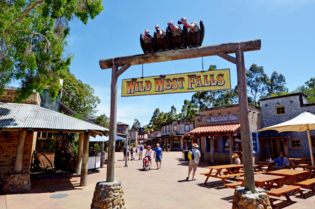 gold coast: GOLD COAST, AUS -  NOV 06 2014:Visitors in Movie World Gold Coast Queensland Australia.The park opened in 1991 and contains various movie-themed rides and attractions.