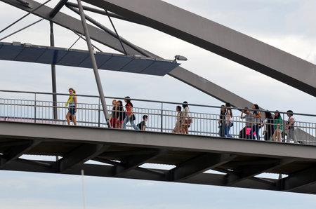 goodwill: BRISBANE, AUS - SEP 25 2014:pedestrian crossing on Goodwill Bridge in Brisbane Australia.Its a pedestrian and cyclist bridge which spans the Brisbane River in Brisbane, Australia.