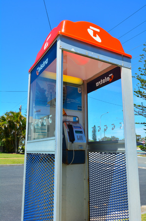 pay phone: GOLD COAST - OCT 10 2014:Telstra telephone booth.Australias largest telecommunications and media company Telstra announces that her forgotten pay phone booths will be repurposed as Wi-Fi hot spots. Editorial