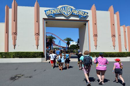 theme park: GOLD COAST, AUS -  NOV 06 2014:Visitors enters Movie World Gold Coast Queensland Australia.The park opened in 1991 and contains various movie-themed rides and attractions.