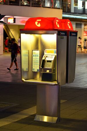 pay phone: SURFERS PARADISE, AUS - OCT 28 2014:Telstra telephone booth.Australias largest telecommunications and media company Telstra announces that her forgotten pay phone booths will be repurposed as Wi-Fi hot spots.