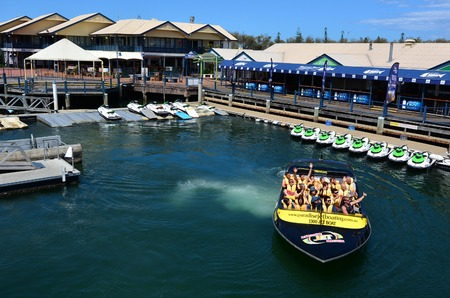 """gold coast: GOLD COAST - OCT 16 2014:Visitors during Jet Boat Rides in Gold Coast Queensland Australia.Its on of the """"must do"""" adventure activity on the Gold Coast. Editorial"""