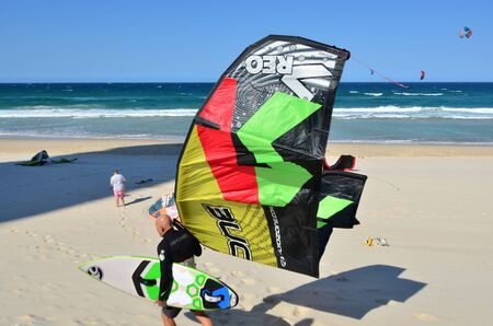 SURFERS PARADISE - SEP 30 2014:Kite surfers kitesurfing over the pacific ocean. Kitesurfing is a very popular water sport in Surfers Paradise in Queensland, Australia.