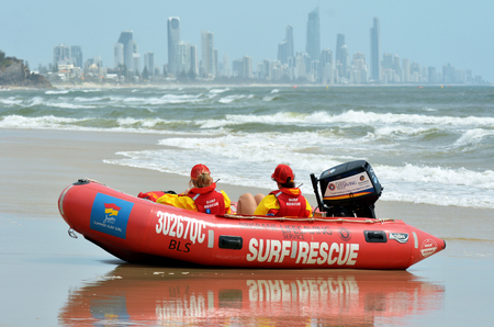 GOLD COAST, AUS - NOV 02 2014:Australian Lifeguards in Gold Coast Australia.Australian Lifeguards are world-renown for their high levels of skill and knowledge in accident prevention and rescue response Editorial