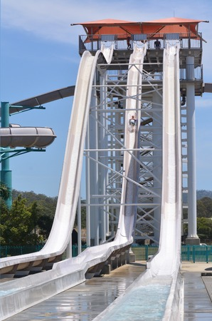 mach 1: GOLD COAST, AUS - OCT 30 2014:Man rid on Mach 5 in WetnWild Gold Coast water park. In 2009, the park received 1,095,000 visitors ranking it first in Australia and eighth in the world