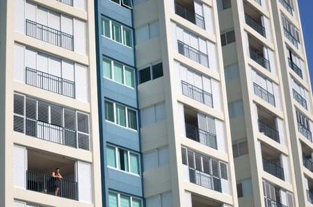 property owners: GOLD COAST - SEP 27 2014:Man looks out from his apartment.Australia Reserve Bank has sent out warning to Australian property owners that it needs to take measures to control the booming housing market Editorial
