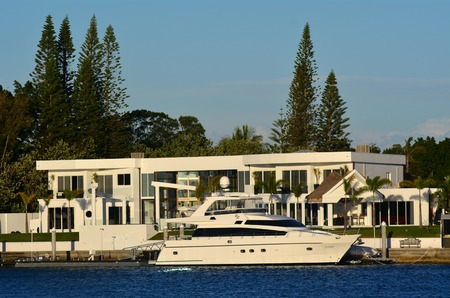 riverside county: GOLD COAST - OCT 14 2014:Luxury home and super yacht in Sovereign Islands.Its one of the most expensive areas in Gold Coast Queensland and Australia with some homes in excess of 20 million dollars. Editorial
