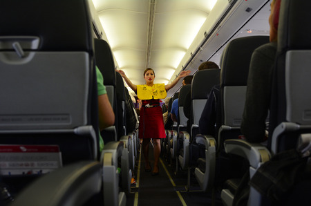 air crew: AUCKLAND - SEP 22 2014:Flight attendant. For planes with up to 19 passenger seats, no flight attendant is needed. For larger planes, one flight attendant per 50 passenger seats is needed.