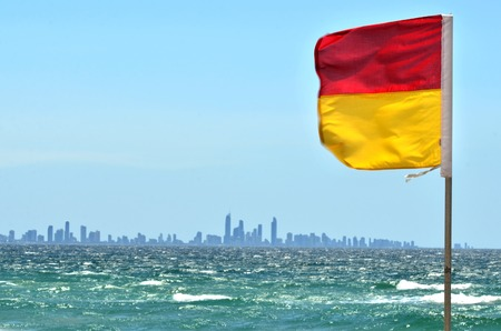first australians: COOLANGATTA - OCT 07 2014:Australian Lifeguards flag.According to Australia National Drowning report 300 people drown in 2012 with cost of $1 billion to the Australian economy.