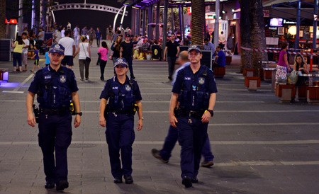 federal police: GOLD COAST, AUS - OCT 28 2014:Police officers patrols in Surfers Paradise. Gold Coast police on high terror alert warned to be hyper vigilant and patrol local mosques and critical infrastructure sites Editorial
