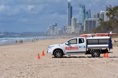 SURFERS PARADISE - SEP 28 2014:Australian Lifeguards in Gold Coast Australia.They are world-renown for their high levels of skill and knowledge in accident prevention and rescue response Editorial