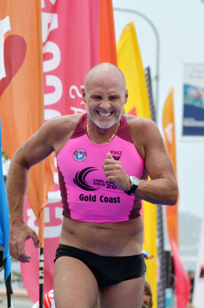 ironman: GOLD COAST, AUS - NOV 2 2014:Grant Kenny race in Coolangatta Gold 2014.The legend Ironman showed all the grit determination that took him to four Australian Ironman championships when he crossed the line.
