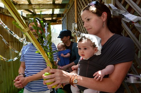 tabernacles: GOLD COAST - OCT 12 2014:Jewish people blessing on the four spices in a Sukkah on Sukkot Jewish Holiday.There are about 100,000 Jewish Australians they are 0.3 percent of the Australian population. Editorial