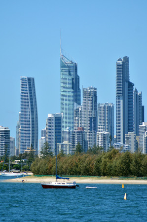 surfers paradise: GOLD COAST - OCT 23 2014:Yacht mooring under Surfers Paradise Skyline.It one of Australias iconic coastal tourist destinations, drawing about 10 million tourists every year from all over the world.
