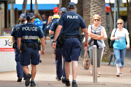 warned: GOLD COAST, AUS - NOV 02 2014:Police officers patrols in Surfers Paradise. Gold Coast police on high terror alert warned to be hyper vigilant and patrol local mosques and critical infrastructure sites Editorial