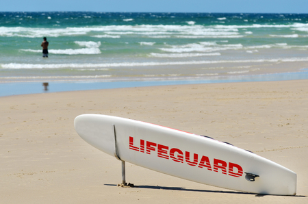 first australians: COOLANGATTA - OCT 07 2014:Lifeguard paddle board in Gold Coast Australia.Australian Lifeguards are world-renown for their high levels of skill and knowledge in accident prevention and rescue response