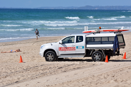 surfers paradise: SURFERS PARADISE - SEP 28 2014:Australian Lifeguards in Gold Coast Australia.They are world-renown for their high levels of skill and knowledge in accident prevention and rescue response Editorial