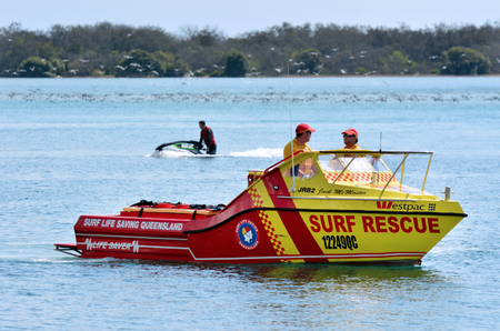lifesaving: GOLD COAST - SEP 27 2014:Australian Lifeguards in Gold Coast Australia.Australian Lifeguards are world-renown for their high levels of skill and knowledge in accident prevention and rescue response