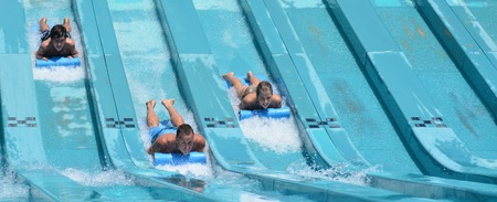 GOLD COAST, AUS - OCT 30 2014:Visitors rids on Super 8 Aqua Racer in WetnWild Gold Coast water park. In 2009, the park received 1,095,000 visitors ranking it first in Australia and eighth in the world