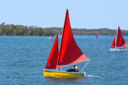 navigable: GOLD COAST - SEP 30 2014:People sail a a dingy. With nine times more waterways than Venice, the Gold Coast is a boating paradise with over 260 kilometers of navigable waterways within the city. Editorial