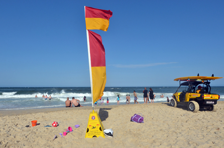 surfers paradise: GOLD COAST, AUS - NOV 02 2014:Australian Lifeguard in Surfers Paradise, Australia.They are world-renown for their high levels of skill and knowledge in accident prevention and rescue response Editorial