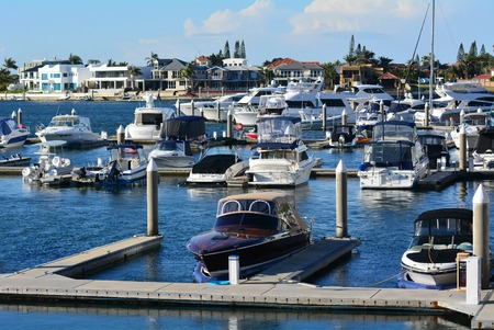 luxurious lifestyle: GOLD COAST - OCT 14 2014:Luxury homes and super yachts in Sovereign Islands.Its one of the most expensive areas in Gold Coast Queensland and Australia with some homes in excess of 20 million dollars. Editorial