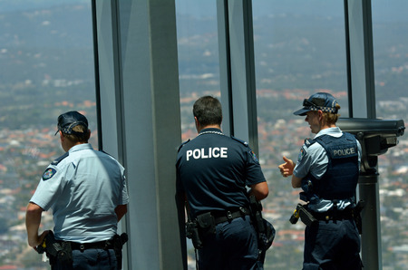 warned: SURFERS PARADISE - NOV 14 2014:Police officers patrols in Skypoint observation deck.Gold Coast police on high terror alert warned to be hyper vigilant and patrol local mosques and critical infrastructure sites