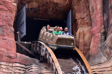 thrill: GOLD COAST, AUS -  NOV 06 2014:Visitors ride on Wild West Falls Adventure Ride in Movie World Gold Coast Queensland Australia.Its an 8-seater flume ride with the largest drop of its kind in Australia. Editorial