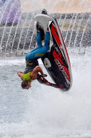 jet skier: GOLD COAST, AUS -  NOV 06 2014:Jet Ski Show in Sea World Gold Coast Queensland Australia.The show is produced by Jon Cooke Entertainment and features some of the worlds best jet ski performers.