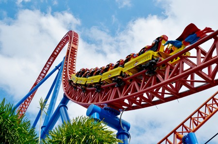 roller coaster: GOLD COAST, AUS -  NOV 20 2014:Visitors ride on Superman Escape in Movie World Gold Coast Queensland Australia.Its an Accelerator Coaster that accelerates from 0 to 100 Km per hour 62 mph in 2 sec. Editorial
