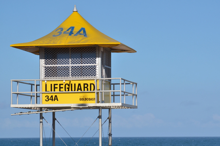 lifesaving: SURFERS PARADISE, AUS - NOV 20 2014:Australian Lifeguards tower. Australian Lifeguards are world-renown for their high levels of skill and knowledge in accident prevention and rescue response