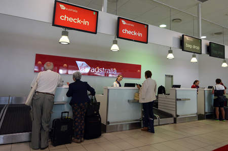 australia: GOLD COAST, AUS - NOV 22 2014:Passengers in Virgin Australia Airlines check in desk.It is Australias second-largest airline as well as the largest by fleet size to use the Virgin brand.