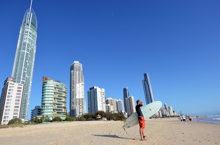 tourist destinations: SURFERS PARADISE - NOV 14 2014:Surfer checking the waves in Surfers Paradise.It one of Australias iconic coastal tourist destinations, drawing millions of surfers from all over the world. Editorial