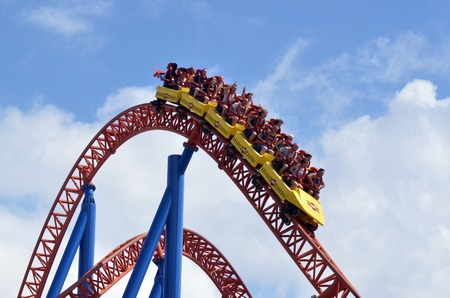 GOLD COAST, AUS -  NOV 20 2014:Visitors ride on Superman Escape in Movie World Gold Coast Queensland Australia.It's an Accelerator Coaster that accelerates from 0 to 100 Km per hour 62 mph in 2 sec.