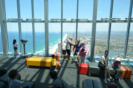 gold coast australia: SURFERS PARADISE - NOV 14 2014:Visitors in Skypoint observation deck.It located 230 metres 750 ft off the ground at the top of the Q1 on the Gold Coast, Australia. Editorial
