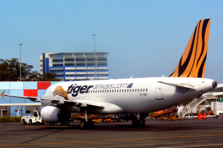 gold coast: GOLD COAST, AUS - NOV 22 2014:Tiger Airways plane in Gold Coast Airport.Tigerair won the CAPA Low Cost Airline of the Year Award for 2006 and 2010. Editorial