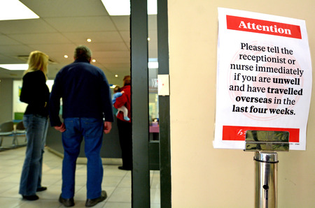 disease patients: PALMERSTON NORTH, NZL - DEC 01 2014:Traveling patient in medical clinic.In October 2014, the CDC determine the level of 21-day monitoring for symptoms and restrictions on public activities