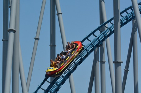 sea world: GOLD COAST, AUS -  NOV 06 2014:Visitors ride on Storm Coaster in Sea World Gold Coast Australia.Its 470m long 1,540 ft ride stands 28m 92 ft tall and features a top speed of 70 Kph 43 mph.